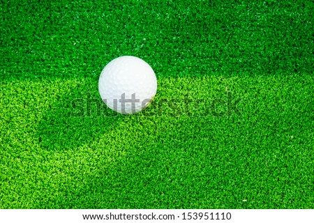 Golf ball on the practice putting mat.  - stock photo