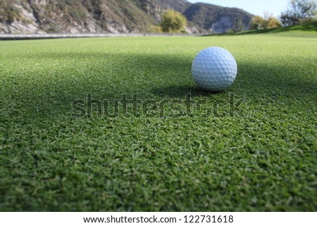 Golf ball on the sod - stock photo