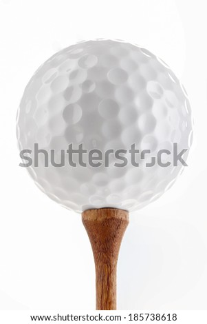 Golf ball on wooden tee, isolated on white. - stock photo
