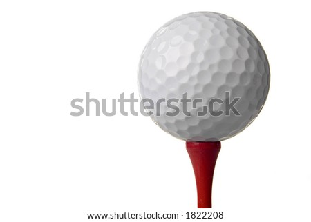 Golf ball(s) on tee in studio. Isolated from background colors.