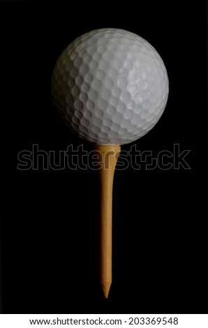 Golf ball tee off on black background