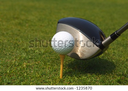 golf ball teed up for hitting with a driver