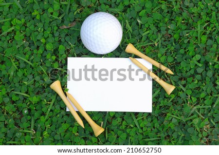 golf ball with empty card - stock photo