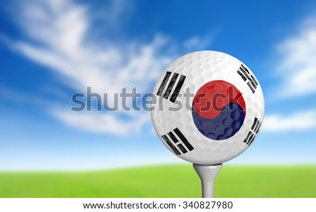 Golf ball with South Korea flag colors sitting on a tee - stock photo
