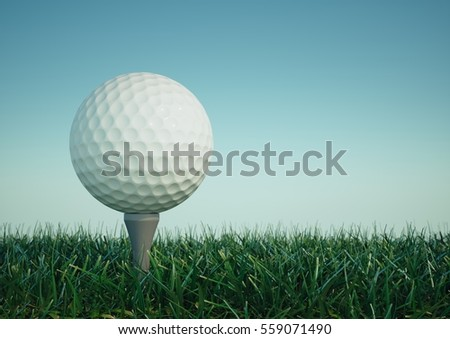Golf ball with tee in the grass on sky background