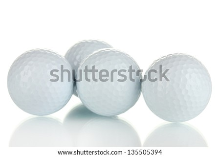 Golf balls isolated on white - stock photo