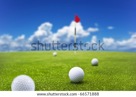 Golf balls on a putting green of a golf course