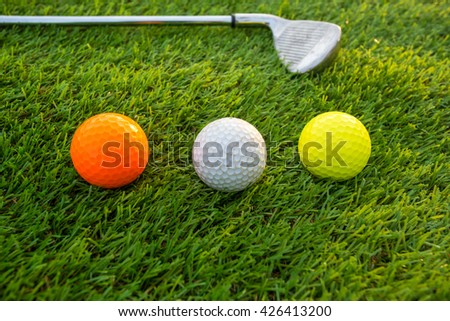 Golf balls on golf clubs - stock photo
