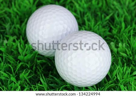 Golf balls on grass close up - stock photo