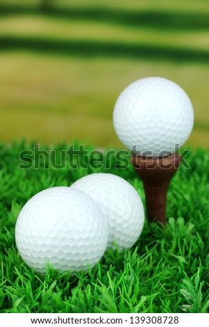 Golf balls on grass outdoor close up - stock photo