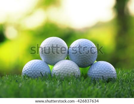 golf balls on green grass background  - stock photo