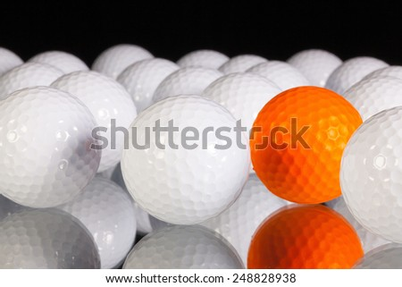 Golf balls on the black glass table - stock photo
