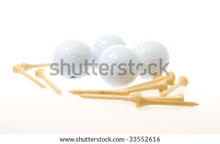 golf balls with tees isolated on white