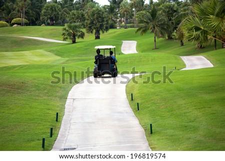 Golf car on the golf course - stock photo