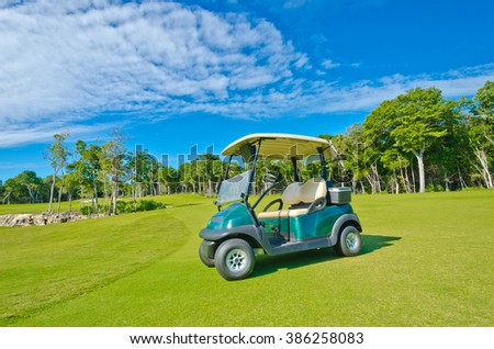 Golf cart at the beautiful caribbean, tropical golf course.