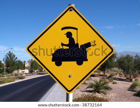Golf cart crossing sign in a affluent desert community. - stock photo