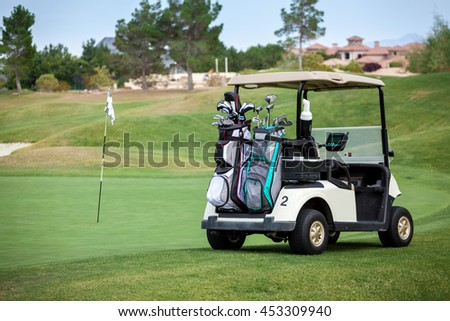 Golf cart on golf course in the afternoon with copy space.