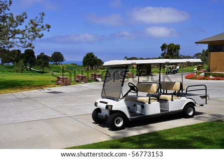 Golf cart waiting for golfers - stock photo