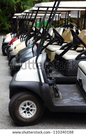 Golf carts on a parking lot - stock photo