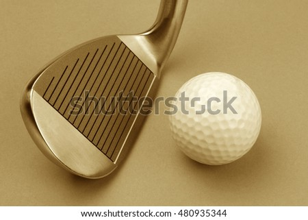 Golf club and ball sepia style image.