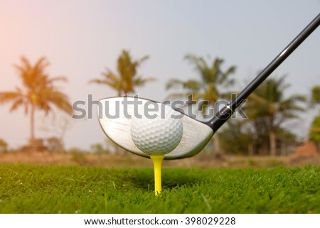 Golf club and golf ball on course - stock photo