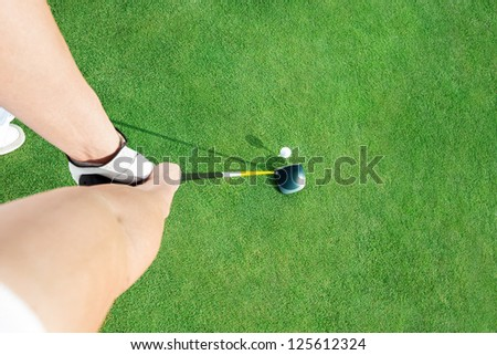 Golf club and golf ball  ready to putting ball, top view - stock photo
