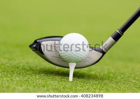 Golf club behind the ball on the fairway