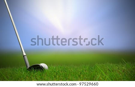 golf club hitting golf ball along fairway towards green with copy space - stock photo
