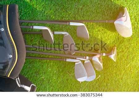 Golf club in bag on green grass - stock photo
