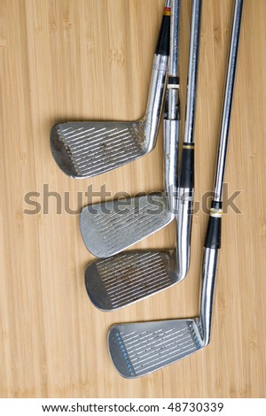 Golf club with  ball on creative background