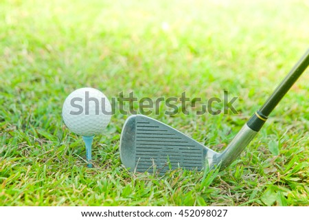 golf club with ball on tee