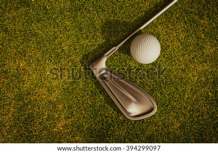 Golf clubs and golf balls on the grass 3d rendering.
