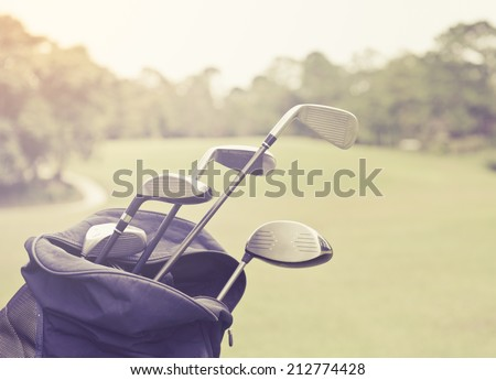 Golf clubs in a bag with you to select the type of shock, picture in retro style. - stock photo