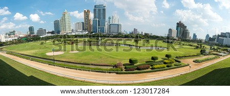 Golf course in the city of Bangkok taken in panoramic technique, on a sunny day - stock photo