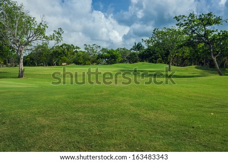 Golf Course in Tropical Paradise. Summertime holyday in Dominican Republic. Tropical Paradise. Dominican Republic, Seychelles, Caribbean, Bahamas. a green tropical forest. Pathway in tropical park.