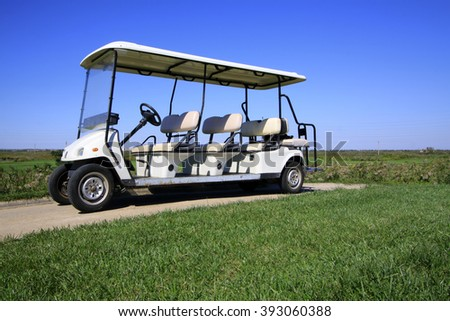 golf course landscape and battery cart, closeup of photo - stock photo