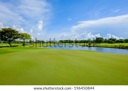 Golf course landscape viewed from the putting green. - stock photo