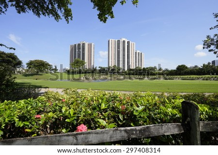 Golf course nature scene with a lake - stock photo