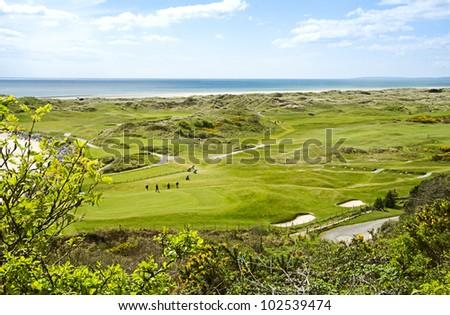 golf course next to the sea - stock photo