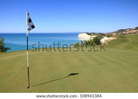 Golf course on the coast - stock photo
