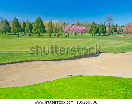 Golf course sand bunker - stock photo