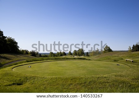 Golf course tee off area with sand trap and fairway in Toronto Ontario, Canada