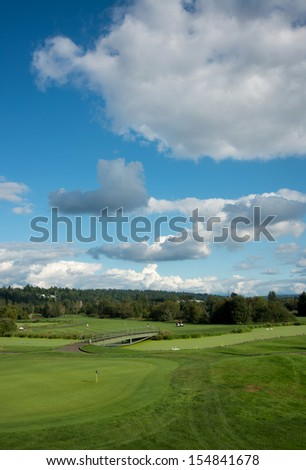 Golf Course Under Dramatic Clouds in Washington State, USA  - stock photo
