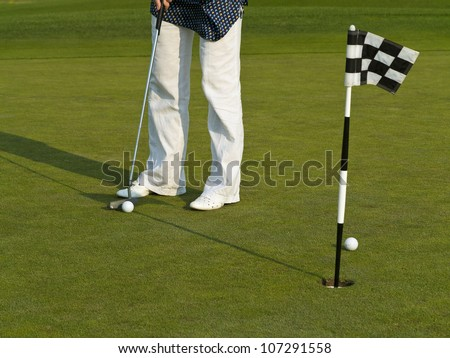 Golf course with ball and flag. - stock photo