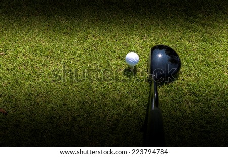 Golf driver driving ball with vignette as abstract - stock photo