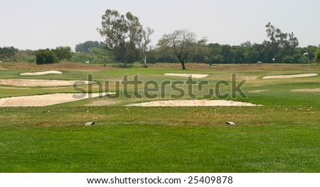 golf driving range or green fairway with bunkers