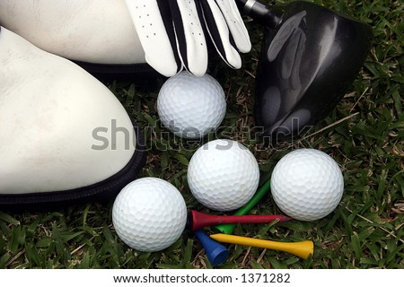 Golf equipment laying on grass