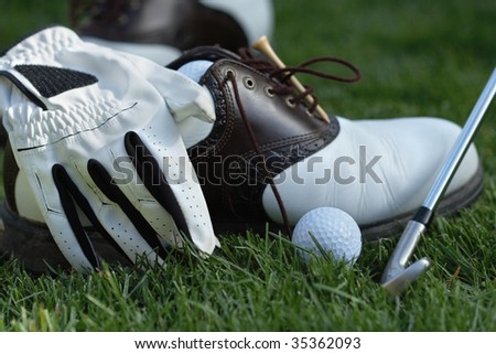 golf equipment on grass - stock photo