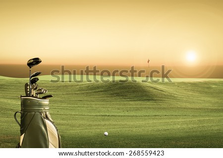 golf equipment on green and hole as background. vintage tone
