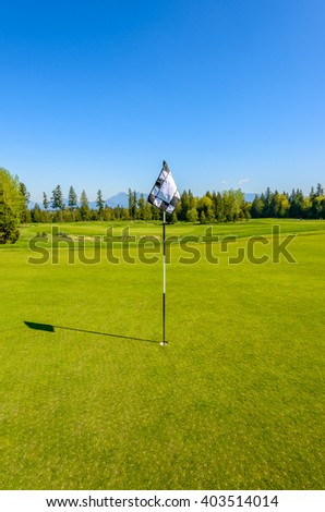 Golf flag at the beautiful golf course. - stock photo